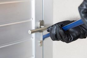 Burglar Breaking In to Home with inadequate security